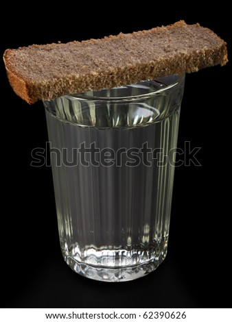 Bread food portion on vodka alcohol drinking glass