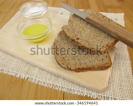 Bread, frozen olive oil and salt - stock photo