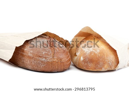 Bread in a paper bag isolated on white background. - stock photo