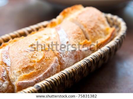 bread in basket - little roll breads in basket on table - stock photo