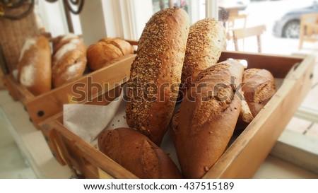 Bread  in basket on shelf in bakery or baker's shop - stock photo