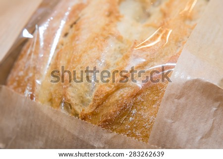 Bread in paper bag close up - stock photo