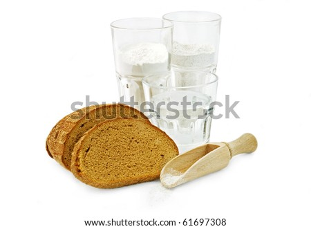 Bread ingredient for bakery. Water, rye and wheat flour and slices of bread