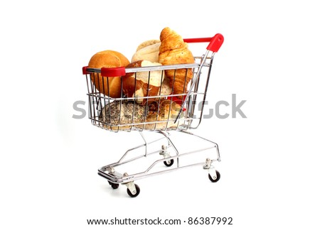 Bread loaf, buns and rolls in a studio setting against white background