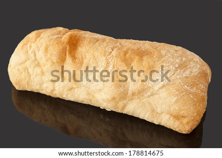 Bread loaf isolated on black background.