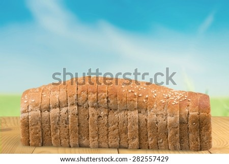 Bread, Loaf of Bread, Sliced Bread. - stock photo