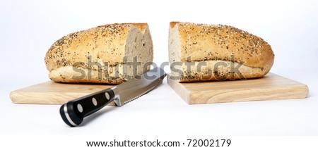 Bread on chopping board - stock photo