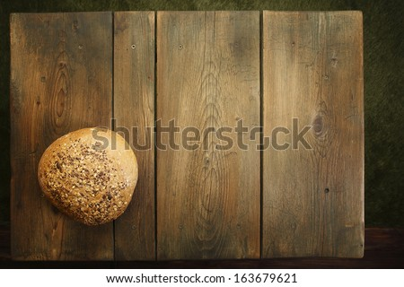 Bread on kitchen table/Cookbook background. An old wooden kitchen table. The homemade bread. - stock photo