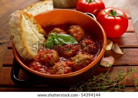 bread on meatballs and tomato sauce - stock photo