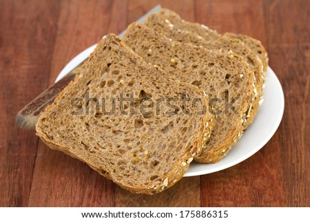 bread on plate with knife