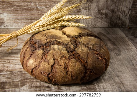 bread on sacking background. Wheat crops.