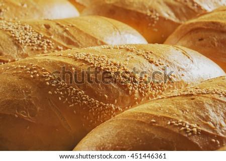 Bread on shelf in bakery or baker's shop - stock photo