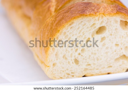 Bread on white plate - stock photo