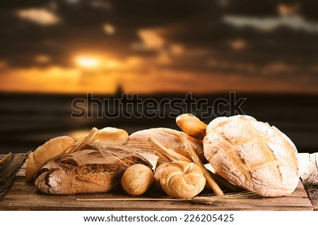 Bread on wooden background - stock photo