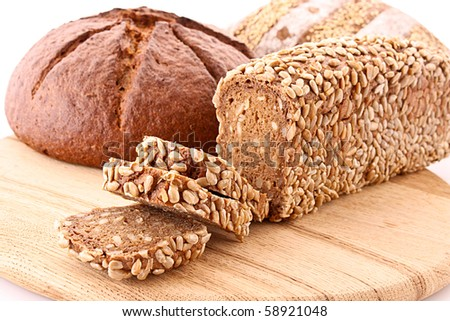 Bread on wooden plate isolated on white - stock photo