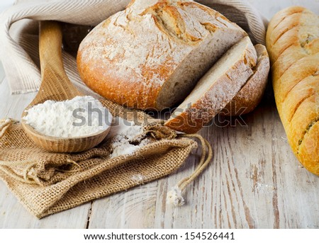 Bread on wooden table. Selective focus - stock photo