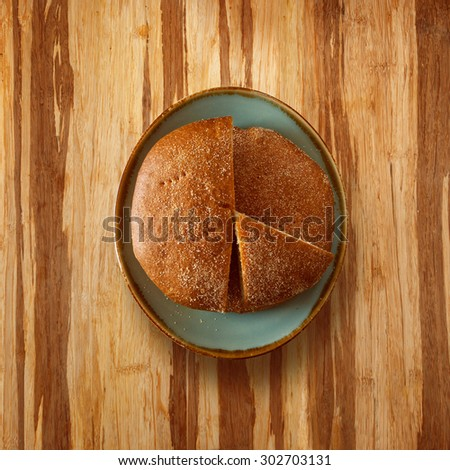bread on wooden table surface - stock photo