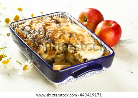 Bread puddings with apples, almond and raisins - stock photo