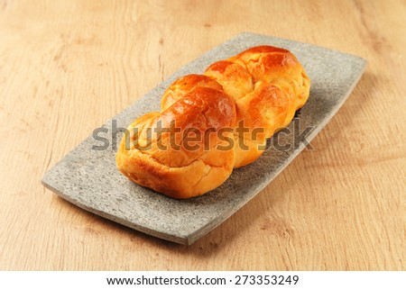 Bread roll on the stone plate      - stock photo