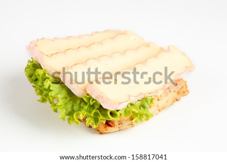 bread roll with camembert - stock photo