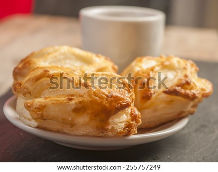 Bread Roll with cottage cheese filling and coffe - stock photo