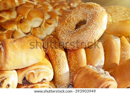 Bread, rolls and other pastries at the counter in the store - stock photo
