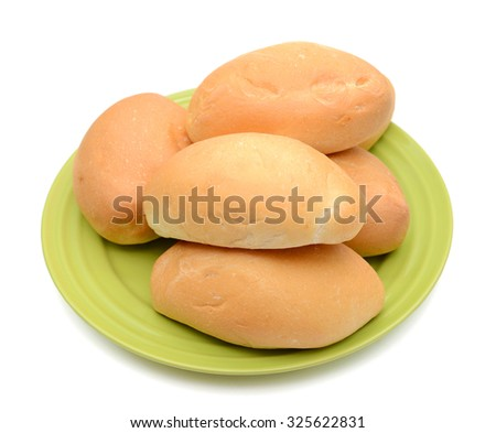 bread rolls on plate isolated on white