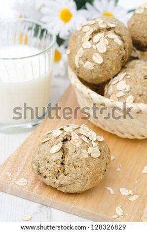 bread rolls wholemeal with oat flakes on a wooden board - stock photo