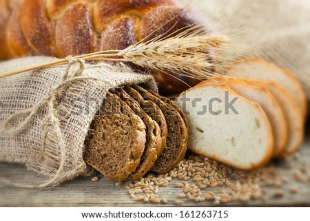 Bread rye spikelets on an old background  - stock photo