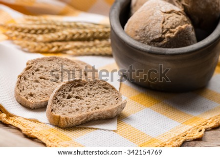 Bread rye spikelets on an old wooden background. - stock photo