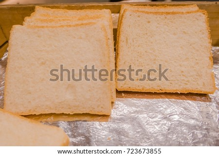 Bread sheet placed  in wooden tray .