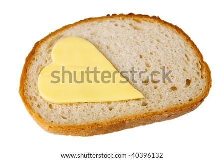 bread slice and butter heart - stock photo