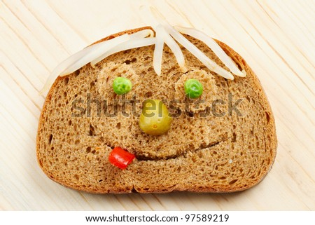 Bread slice as smiling face - stock photo
