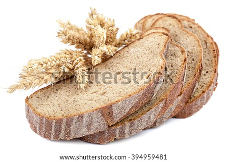 Bread sliced and wheat ears isolated on white background. - stock photo