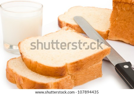 bread slices and milk with clipping path - stock photo