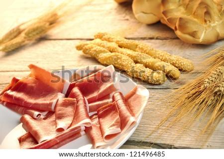 bread-stick and ham - stock photo