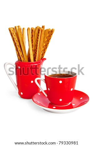 Bread sticks and coffee in the red utensil isolated on a white background - stock photo