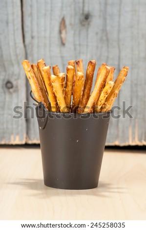 Bread Sticks in a bucket   - stock photo