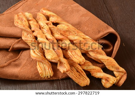 Bread sticks infused with cheddar cheese - stock photo