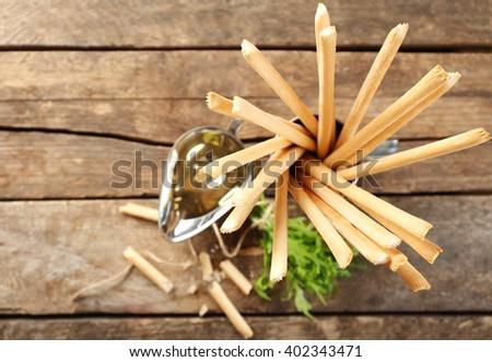 Bread sticks with arugula and oil, closeup - stock photo