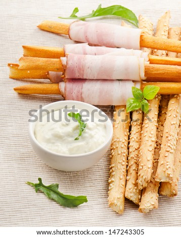 Bread sticks with bacon and herbs. Selective focus