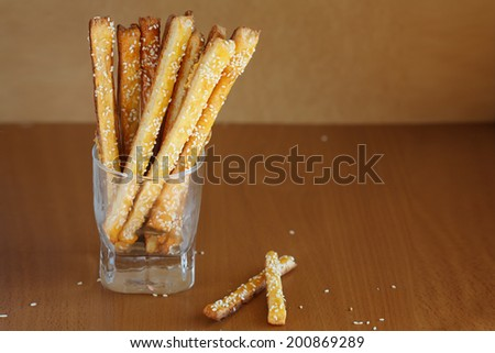Bread sticks  with cheese and sesame in the glass - stock photo