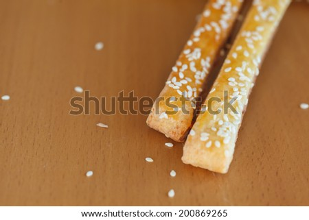 Bread sticks  with cheese and sesame on  the table, close up - stock photo