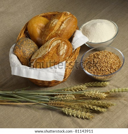 Bread still-life with wheat, bread and flour - stock photo