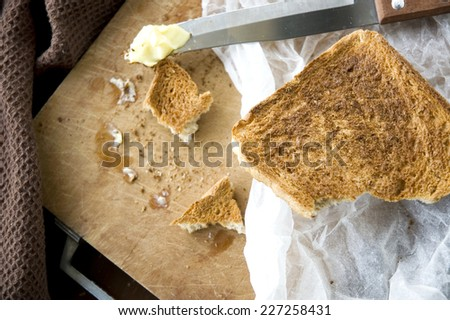 bread toast with butter in messy kitchen - stock photo