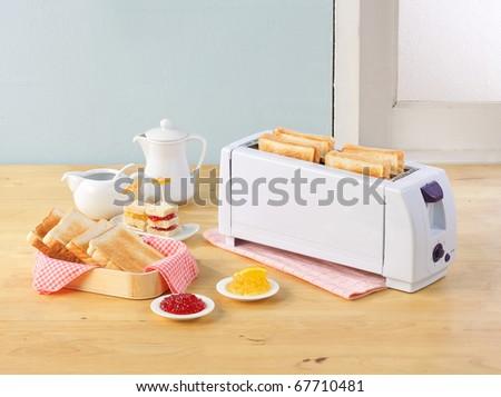 Bread toaster a necessary kitchenware in the kitchen interior  - stock photo