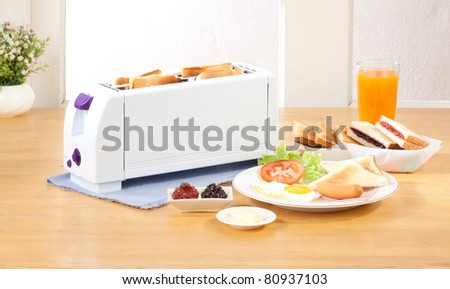 Bread toaster makes your breakfast more easy, the image isolated in the kitchen interior - stock photo