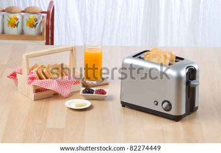Bread toaster the kitchenware you need for preparing your breakfast - stock photo