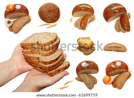 Bread, wheat ears, onions, garlic and salt isolated on the white background