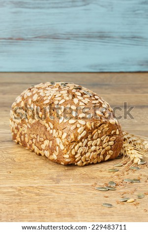 Bread. Whole wheat sunflower seed bread on a table. Macro, selective focus - stock photo